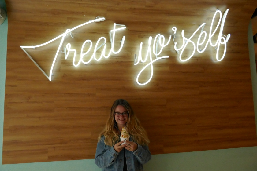 Posing with the neon sign at Milk & Cream Cereal Bar