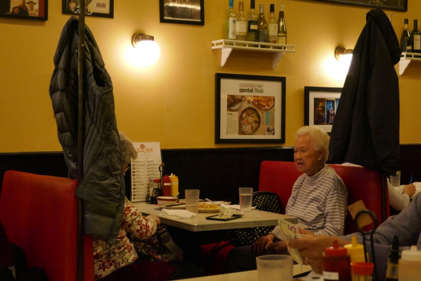 Two old ladies eating dim sum at Nom Wah Tea Parlor in New York